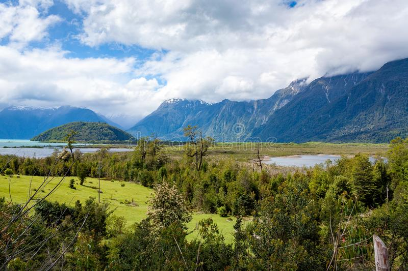 Wide view of a remote region of Patagonia with mountains and lake. Set of images of the La Junta region, southern Chile. After some rain the clouds were still royalty free stock image