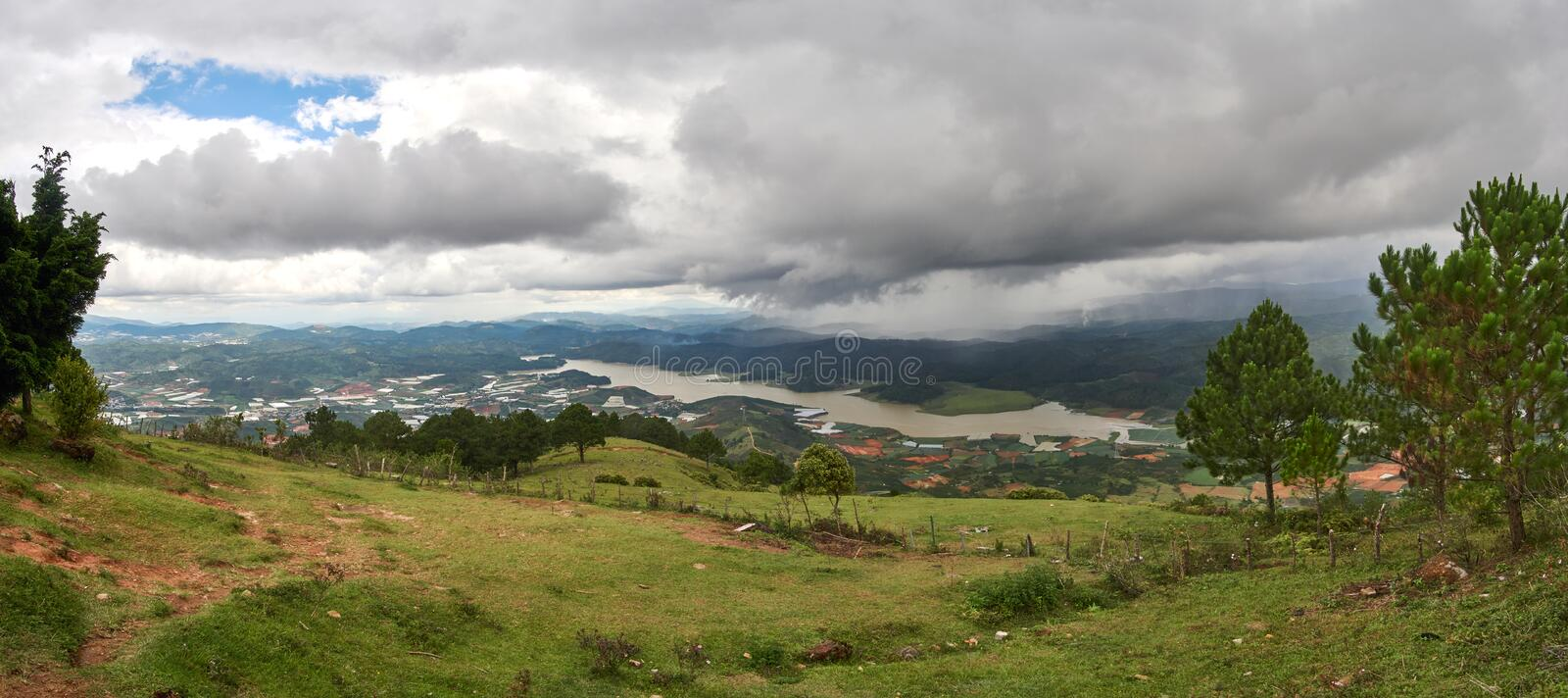 Wide view with storm and rain clouds from the mountain lang biang in Da-lat, Vietnam. royalty free stock photo