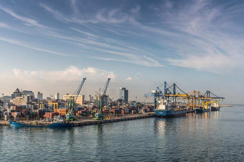 Wider view, Early Morning container port of Makassar, South Sulawesi, Indonesia. Makassar, Sulawesi, Indonesia - February 28, 2019: Wider view. Early morning sky royalty free stock image