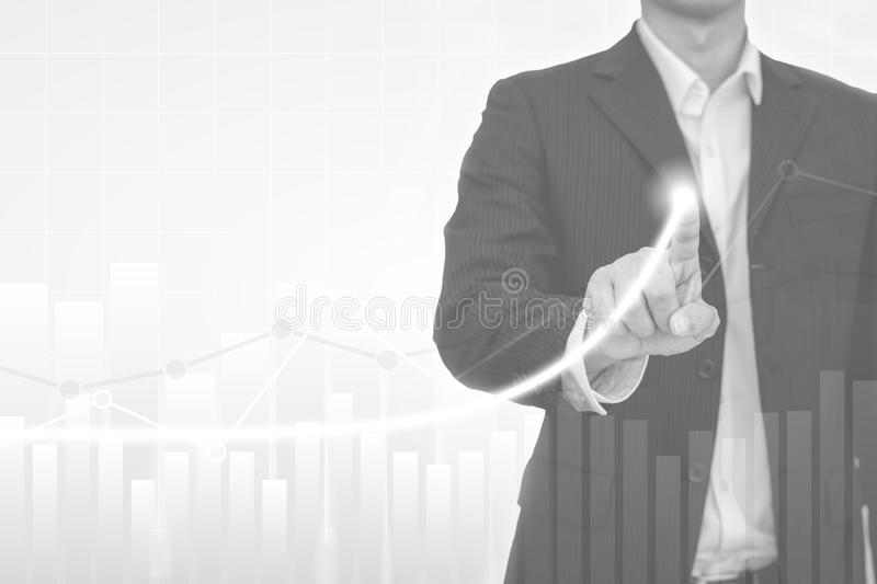 Widescreen Abstract financial graph with business man pointing finger to uptrend line arrow and bar chart of stock market on black stock photo