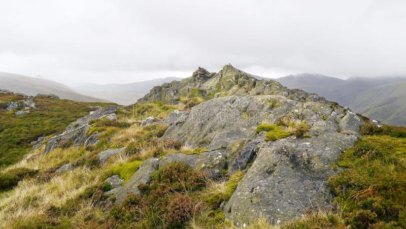 Sergeant`s Crag summit, Lake District. Widescreen image of the approach to Sergeant`s Crag summit, above the Langstrath valley royalty free stock image