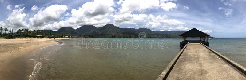 Widescreen Panorama View of Hanalei Pier and Bay, Kauai, Hawaii, USA royalty free stock images
