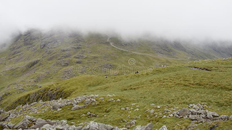 Looking to Scafell Pike path with low cloud descending stock image