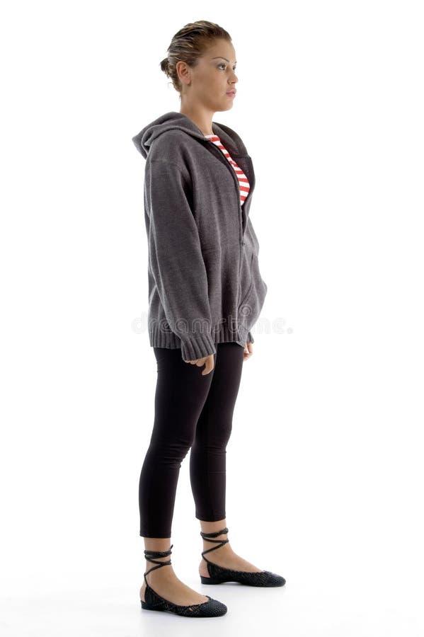 widok boczna trwanie kobieta obrazy stock