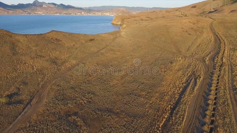 Widok z lotu ptaka na plaży Sudak w Crimea, Czarny Dennego wybrzeża strzał Krymski wybrzeże z góry Piękny Krymski obraz stock