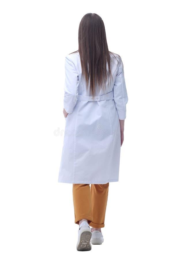 Widok z tyłu kobiecy lekarz przyglądający się przestrzeni kopiowania zdjęcia stock