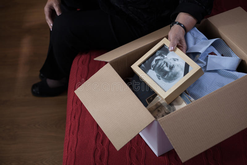 Widow packing things into box royalty free stock images
