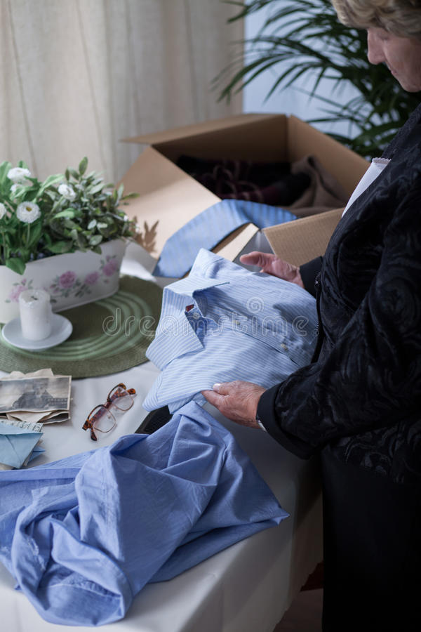 Widow packing things of husband royalty free stock photo