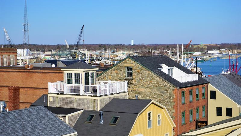 Rooftop widow`s walk in New England. Widows walk platform on a rooftop in New Bedford, Connecticut has been renovated with a white picket fence.  Overlooking the stock photo