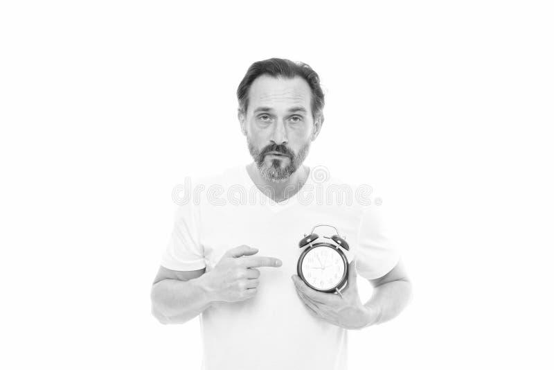 Wie spät ist es? Zeitmanagement und Disziplin Pünktlichkeit und Verantwortung Mann mit Uhr auf weißem Hintergrund lizenzfreie stockbilder