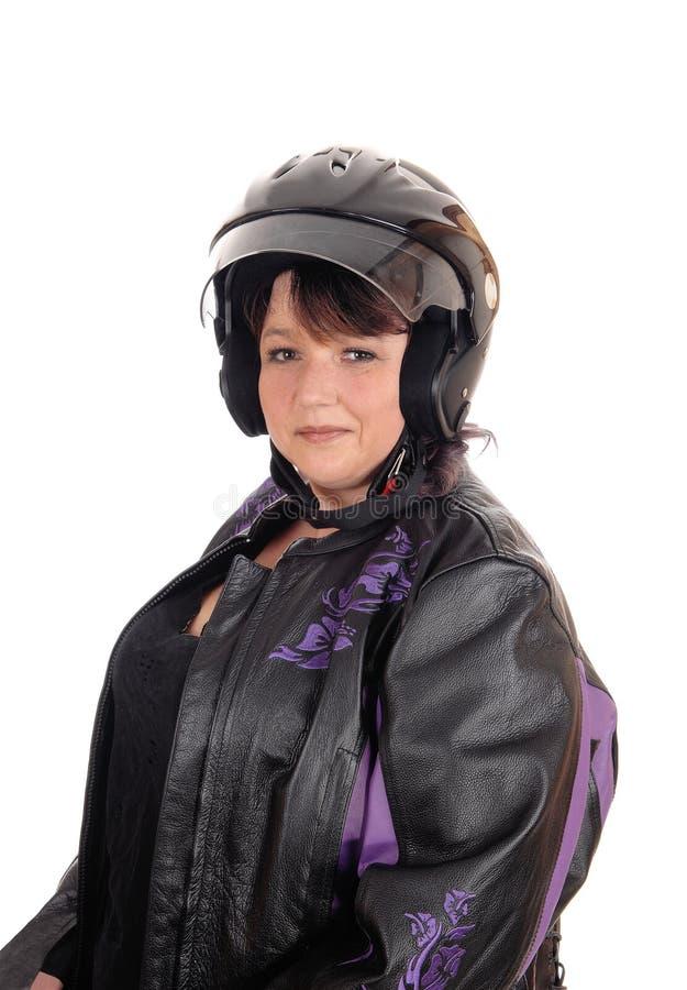 Wiek średni kobieta z hełmem i kurtką obrazy stock