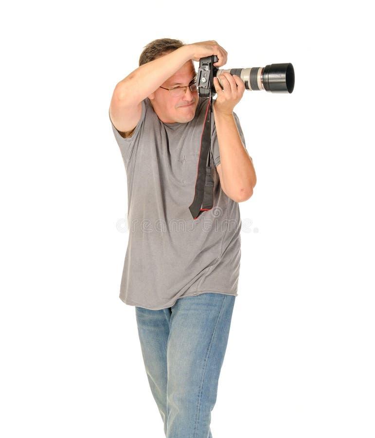 Wieka średniego mężczyzna portret z dslr kamerą i dużym tele obiektywem obrazy stock