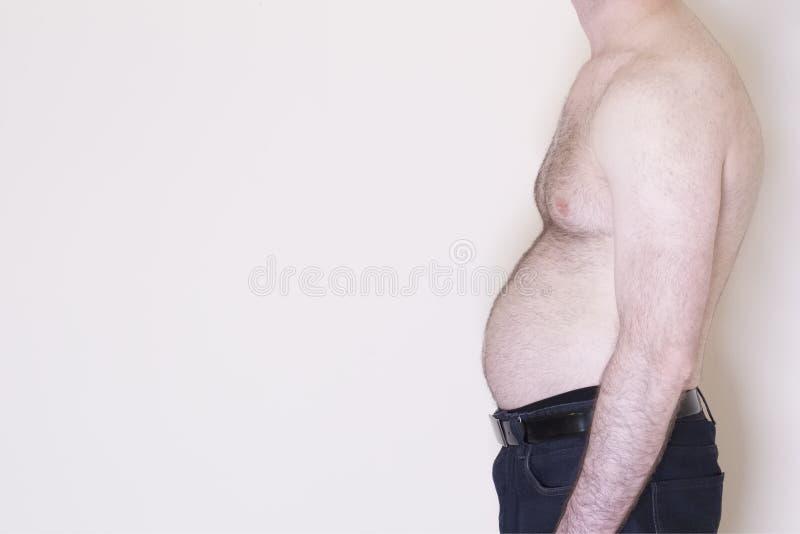 Wieka średniego piwnego brzucha brzuszka mężczyzna rozciągniętych z nadwagą męskich zdrowie stylu życia otyłości ciężaru niezdrow zdjęcie royalty free