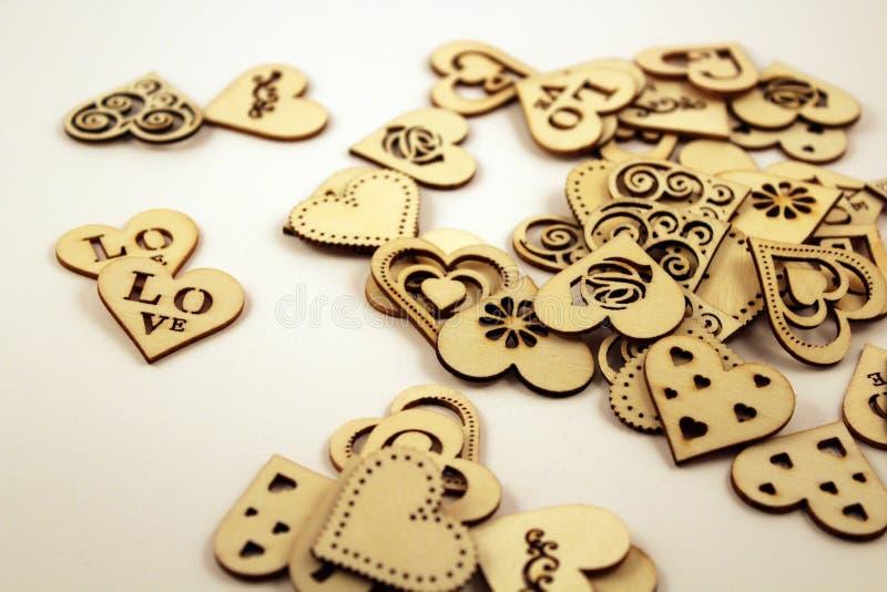 Wiele drewniani serca na białym tle obraz royalty free