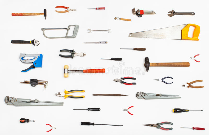 Wiele ręk narzędzia układający na bielu obrazy stock