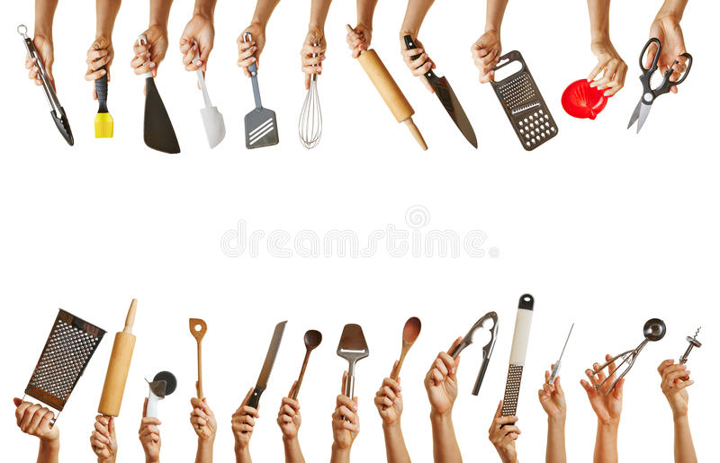 Wiele ręki trzyma różnych kuchni narzędzia obraz royalty free