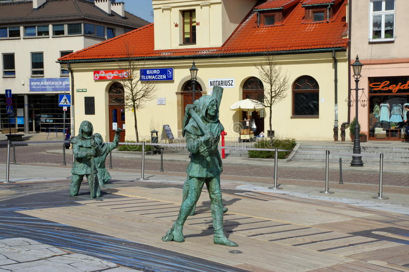 Wieliczka, Hoger Vierkant Beeldhouwwerken van oud mijnwerkerszout royalty-vrije stock foto