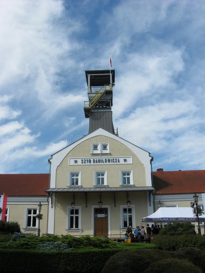 Wieliczka Salt Mine. Building of the underground salt mine and picturesque cloudy sky as a background stock photo