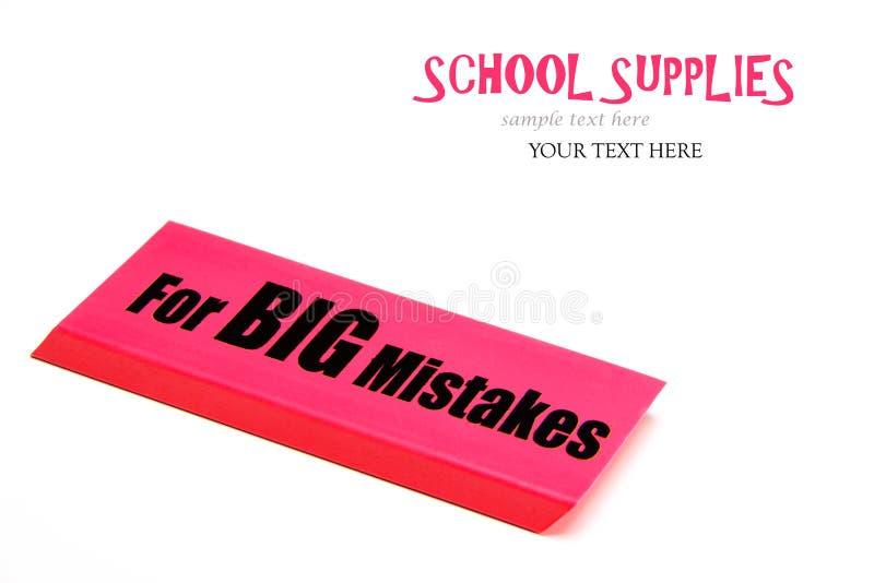 Wielka czerwona gumka z wiadomością dla dużych błędów kątomierz zamknięta cyrklowa szkoła ximpx cyrklowy zdjęcie stock