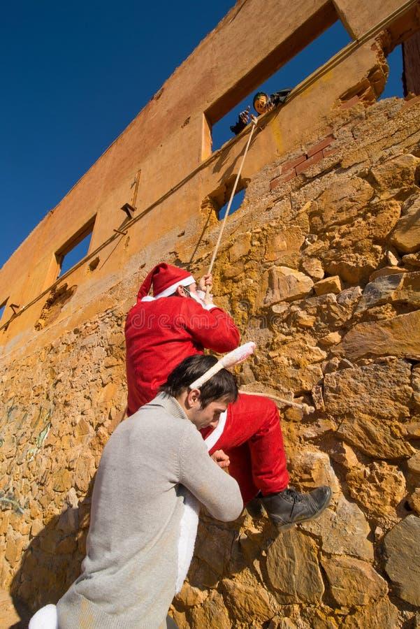 Wielkanocny królik pomaga Santa zdjęcie royalty free