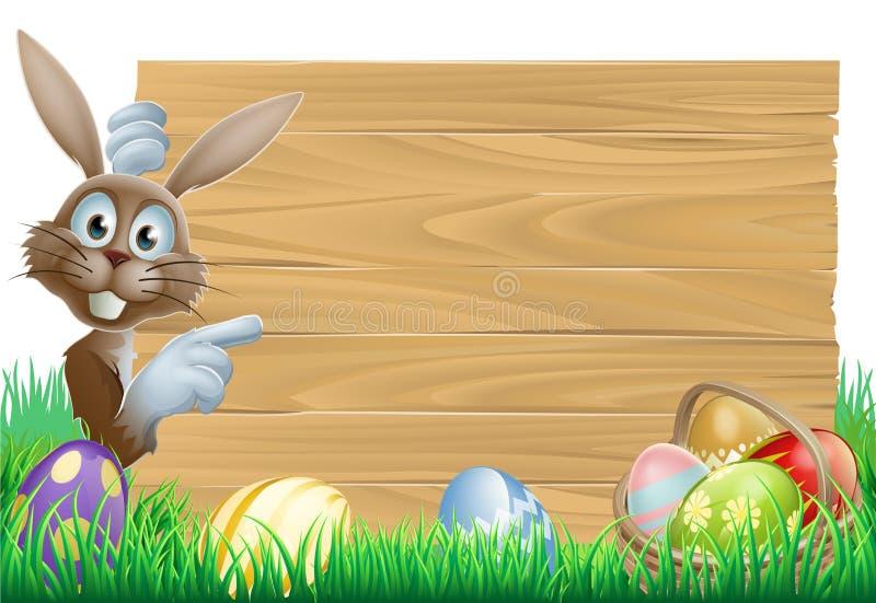 Wielkanocny królik wskazuje przy znakiem ilustracji