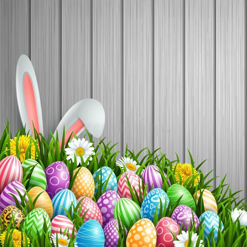 Wielkanocny tło z królików ucho, kwiatami i barwiącymi dekorującymi jajkami w trawie na drewnianym tle, ilustracja wektor
