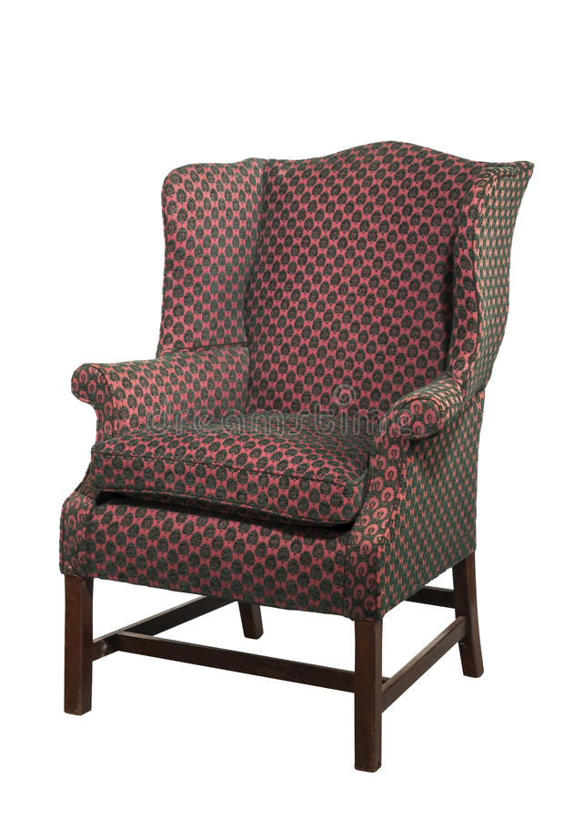 Wielki skrzydłowy krzesło tapicerujący w czerwonym starym antyku odizolowywającym obraz stock