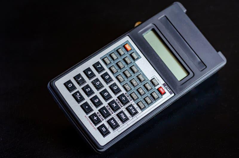 Wielofunkcyjny kalkulator Materiały rzeczy zeszły wiek By? mo?e Makro- mi?kkie ogniska, obraz stock