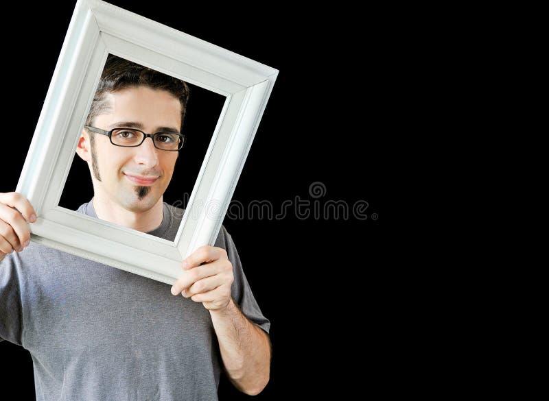 Wieloskładnikowe fotografie młody człowiek z biel ramą obraz stock