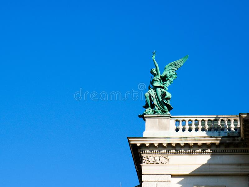 Wien/Austria - june 3 2019: Detail of a bronze sculpture of an angel on the top of a palace in Vienna Austria. Copy space stock image
