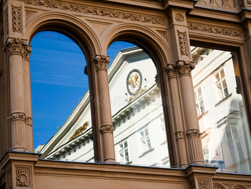 Wien/Austria - june 3 2019: reflection of the facade of a palace over the Windows of other palace. In Vienna Austria stock image