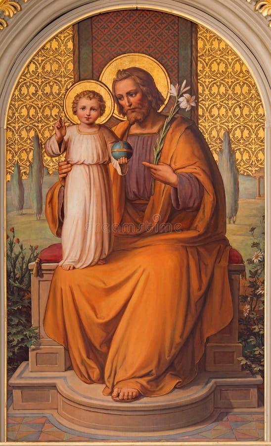 Wien - den St Joseph målarfärgen av Josef Kastner det äldre från 20 cent i den kyrkliga Muttergotteskirchen royaltyfri bild