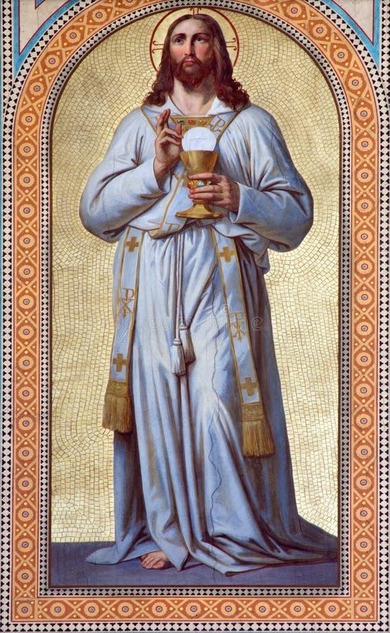 Wien - freskomålning av Jesus Christ som prästen av Karl von Blaas från. cent 19. i skepp av den Altlerchenfelder kyrkan royaltyfria bilder