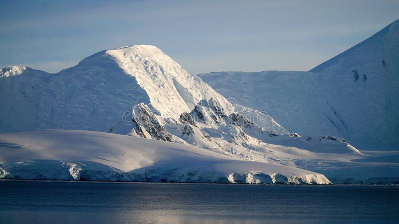 Wiencke Island / Dorian Bay landscape with snowy mountains in Antarctica.  royalty free stock photo