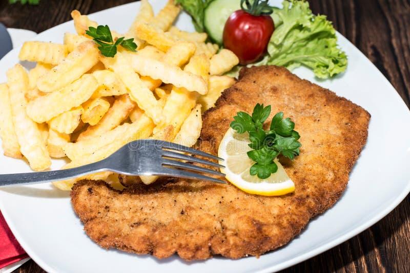 Wiener Schnitzel with Chips stock photo