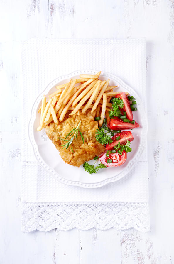 Wiener Schnitzel with French Fires and Tomatoes royalty free stock photos