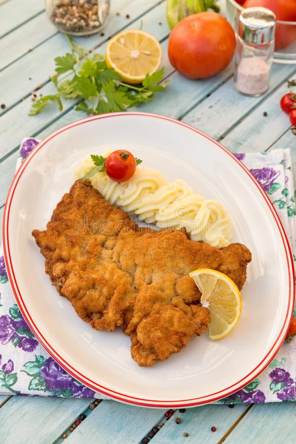Wiener Schnitzel with mashed potatoes royalty free stock images