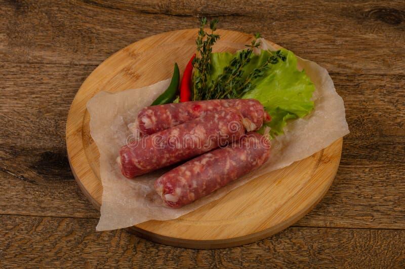 Wieprzowin surowe kiełbasy zdjęcie stock