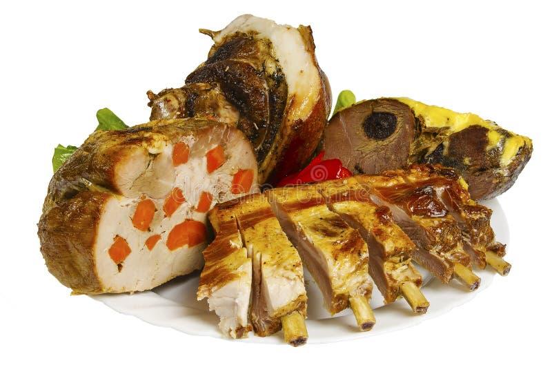 Wieprzowina i ziobro dziki knur piec na grillu na talerzu, odosobnionym zdjęcie royalty free