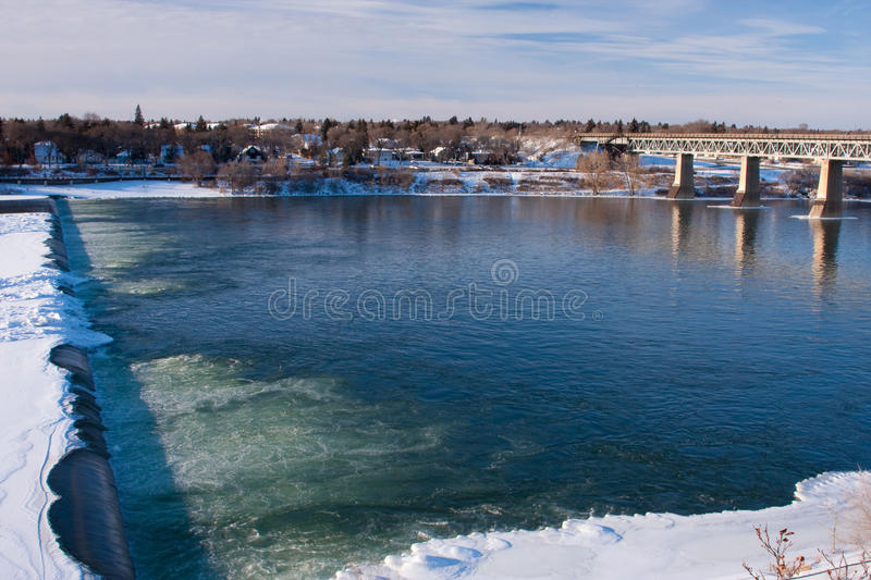 Wier over River in Winter royalty free stock image