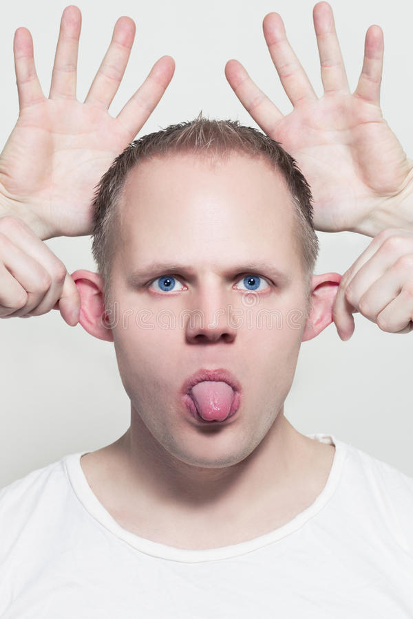 Download Wierd Face stock image. Image of holding, wierd, forhead - 29644491