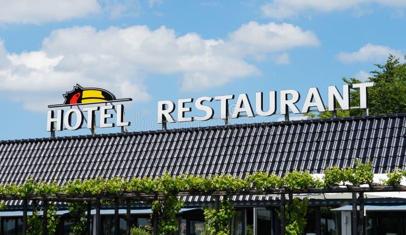 Van der Valk hotel and restaurant. Wieringerwerf, the Netherlands. May 2019. Hotel and restaurant with the logo of Van der Valk, A Dutch hotel and restaurant stock photography