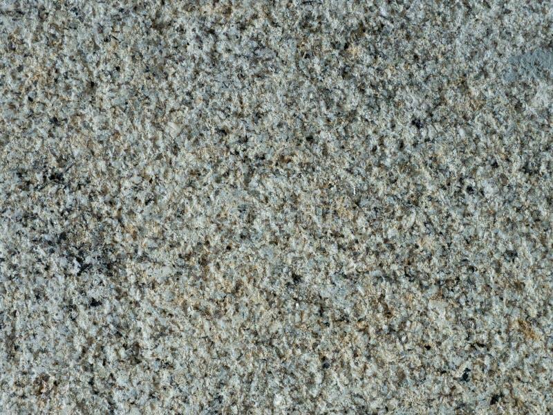 Wietrzejąca, stara granit ściana z szorstkim tekstury tłem, obrazy royalty free