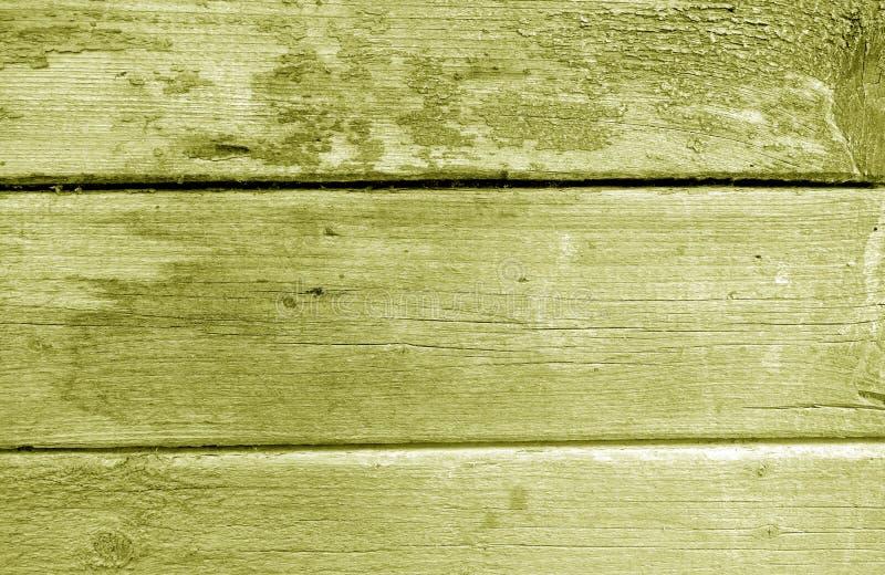 Wietrzejąca drewniana malująca ściana w żółtym brzmieniu obrazy royalty free