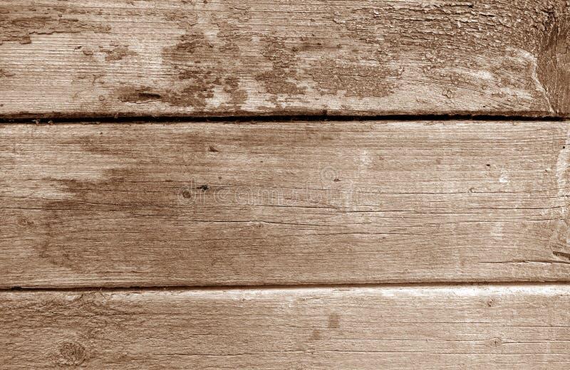 Wietrzejąca drewniana malująca ściana w brązu brzmieniu fotografia royalty free