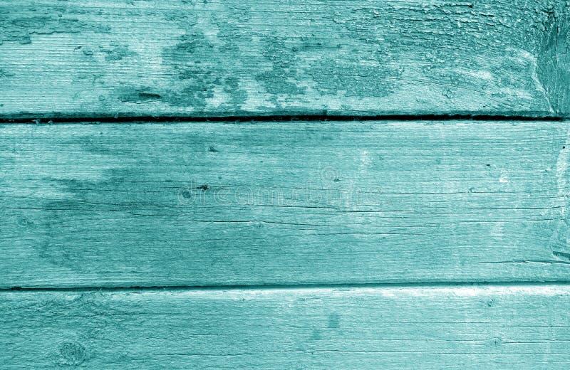 Wietrzejąca drewniana malująca ściana w cyan brzmieniu zdjęcia royalty free