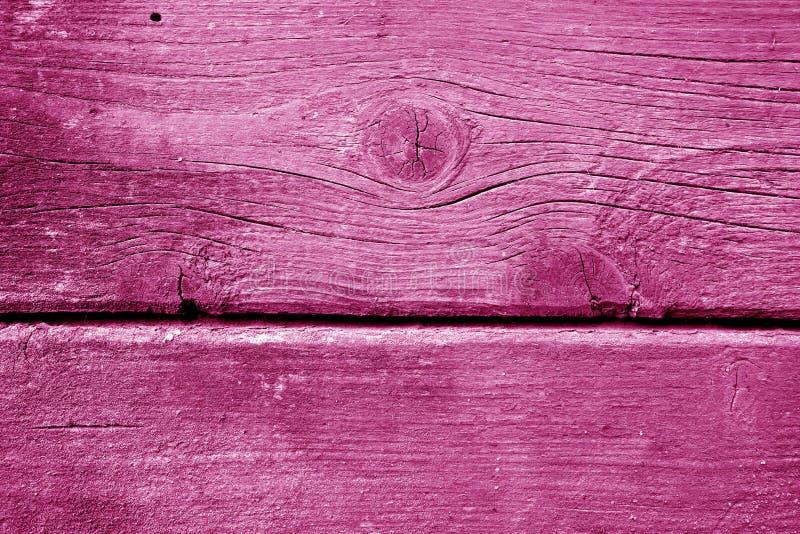 Wietrzejąca drewniana malująca ściana w menchia kolorze obrazy stock