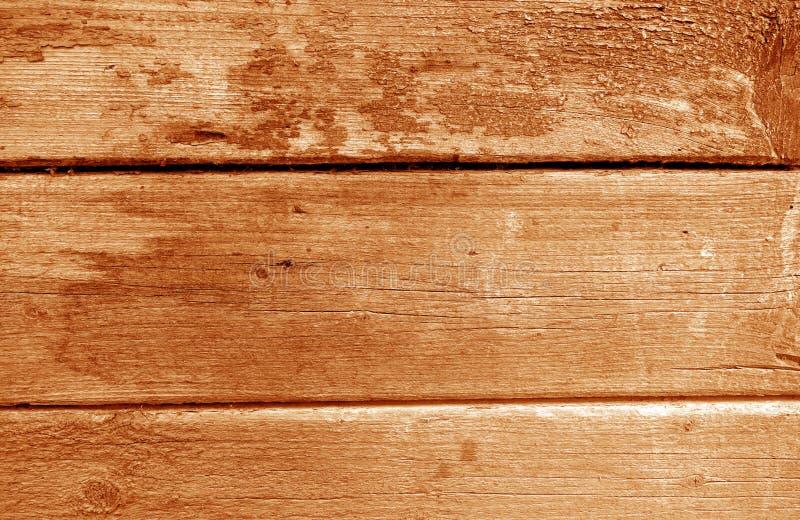 Wietrzejąca drewniana malująca ściana w pomarańczowym brzmieniu zdjęcia stock