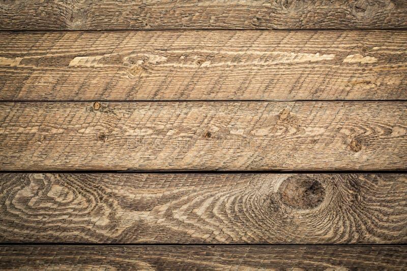 Wietrzejący i nieociosany stajni drewna tło zdjęcie stock