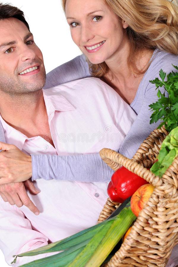 Wife with arms around husband. Wife putting arm around her husband stock image